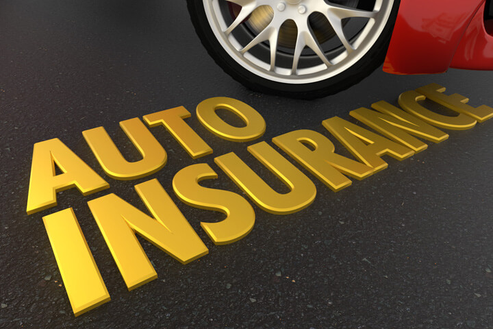 Gold auto insurance text on road in front of red sports car