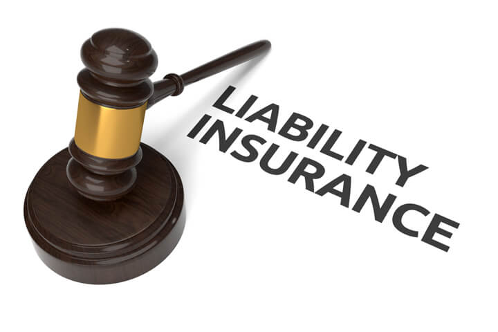 Gavel with liability insurance text isolated on white