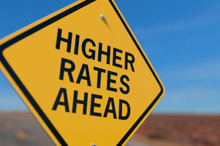 Road sign indicating higher auto insurance rates