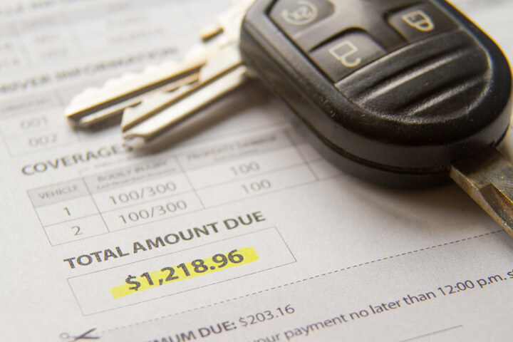 Auto insurance bill showing amount due with car keys