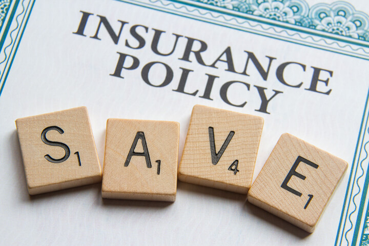Insurance policy with Scrabble letters reading SAVE concept for saving money on insurance