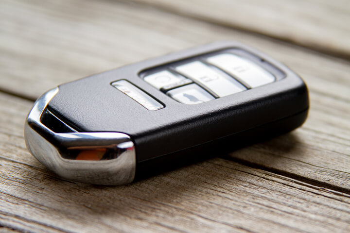 Photo of a vehicle keyless entry remote on weathered wood planks