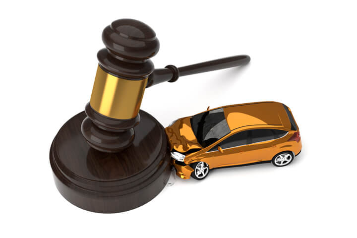 Small orange car crashed into side of gavel view from top liability concept image