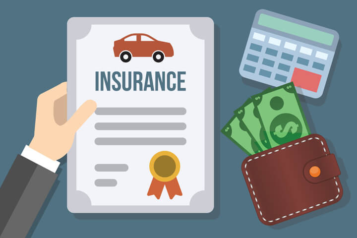 Hand holding auto insurance policy with cash sticking out from wallet and calculator concept for the cost of auto insurance