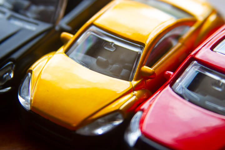 Angled view photo of three toy cars close up