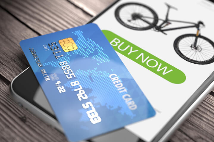 Mobile phone showing buy now button with credit card concept for mobile shopping