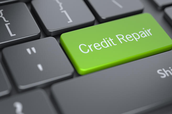 Concept image of credit repair with dark laptop keyboard