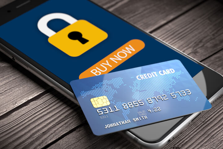 Mobile phone showing secure padlock icon with buy button and credit card