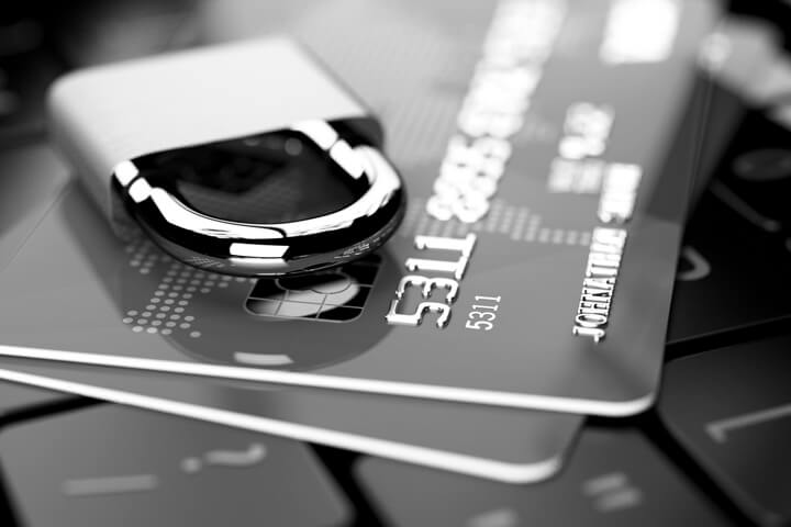 Credit cards on keyboard with padlock in black and white