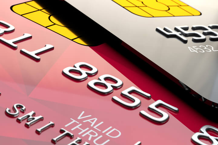 Close up view of shiny red and black credit cards with EMV chips