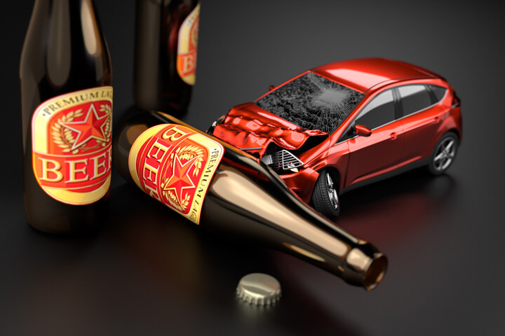 Red car crashed into beer bottle laying on side concept for drunk driving or DUI with dark background