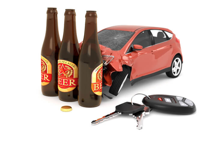 Car crashed into three beer bottles with car keys on ground concept for DUI or drunk driving