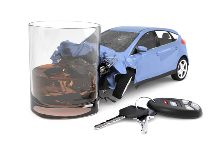 Drunk driving concept of small blue car collision with alcoholic drink isolated on white background with car keys