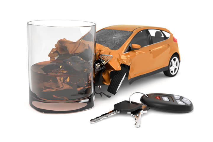 Orange compact car smashed into whiskey glass with car keys and key fob