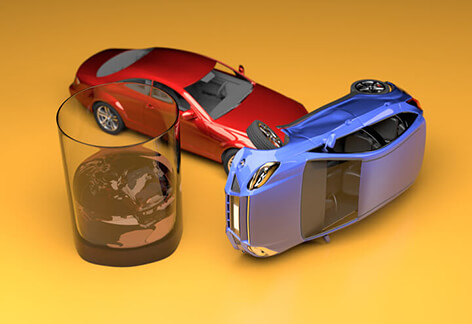 Car accident next to glass of whiskey from drunk driving stylized with gold colored studio background