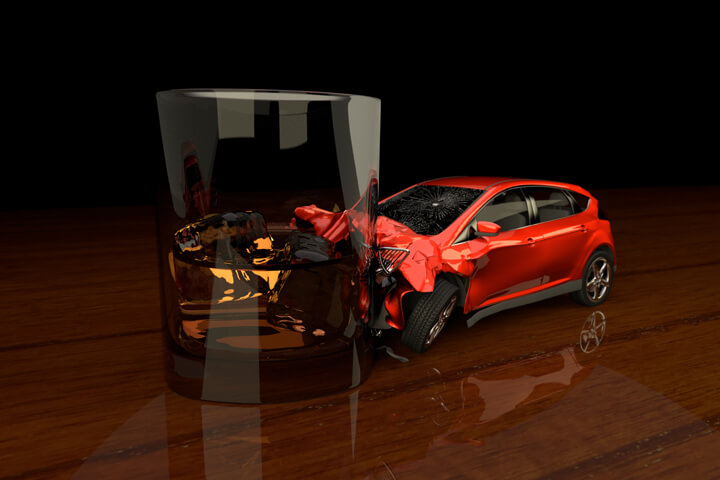 Small red car crashed into liquor glass concept for driving under the influence