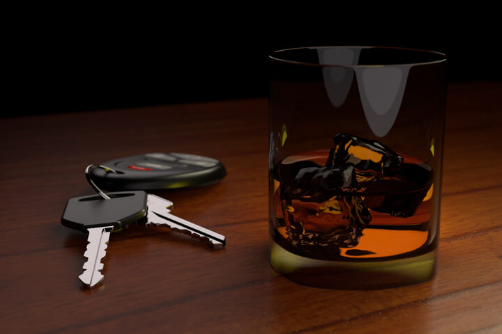 Drunk driving concept white car keys and drink on bar