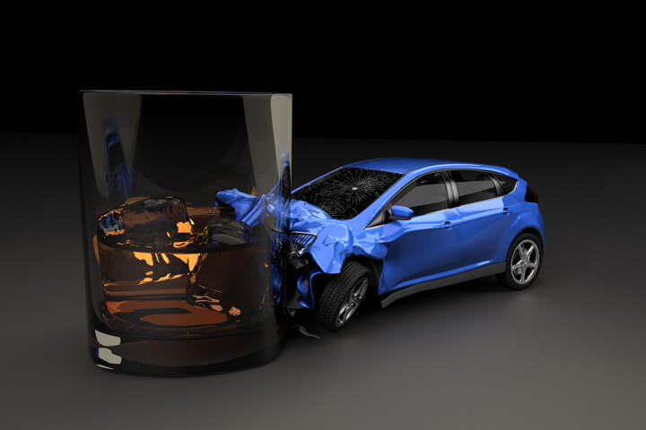 Small blue car smashed into bourbon glass representing the consequences of driving drunk