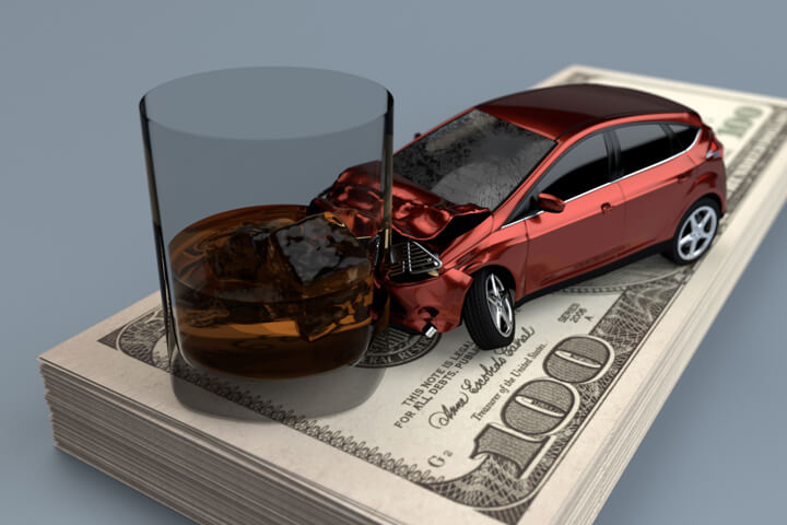Drunk driving concept image showing DUI accident on large stack of US one hundred dollar bills