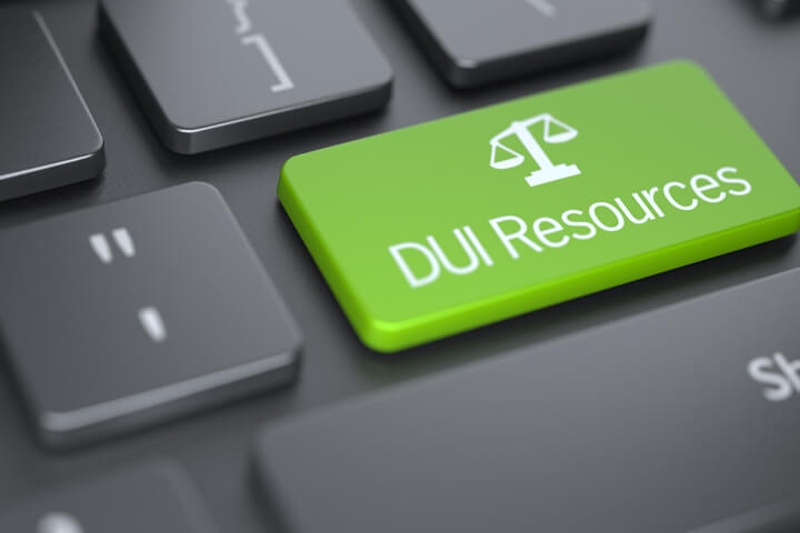 Dark keyboard with large green DUI Resources key concept for finding information about DUI online