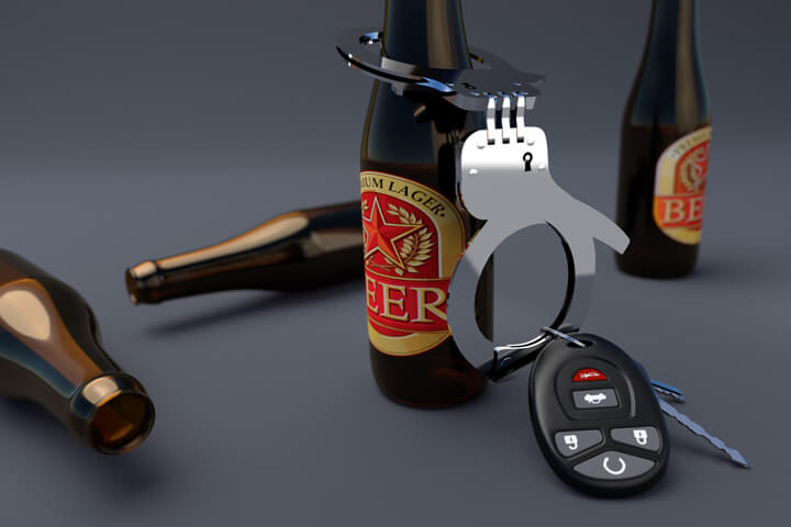 Car keys handcuffed to a beer bottle DUI arrest concept image