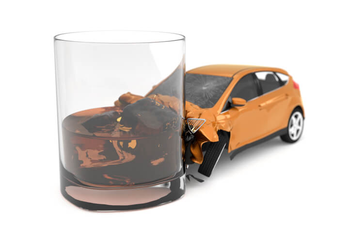 Drunk driving concept of small orange car collision with alcoholic drink isolated on white background