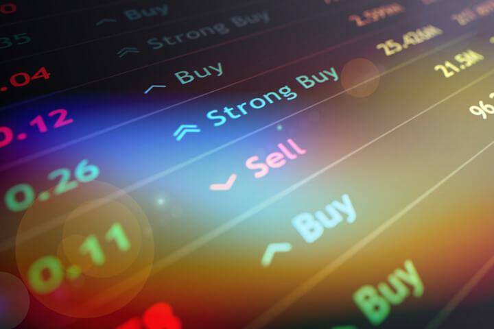 Stock ticker chart with buy, sell, and strong buy recommendations with lens flare