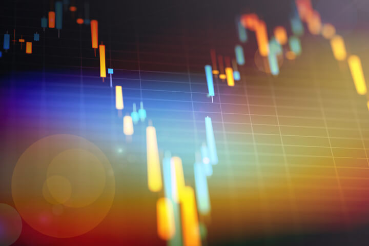 Closeup of candlestick stock price chart with lens flare and overlay