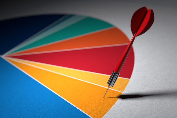 Colorful pie chart with dart targeting one segment