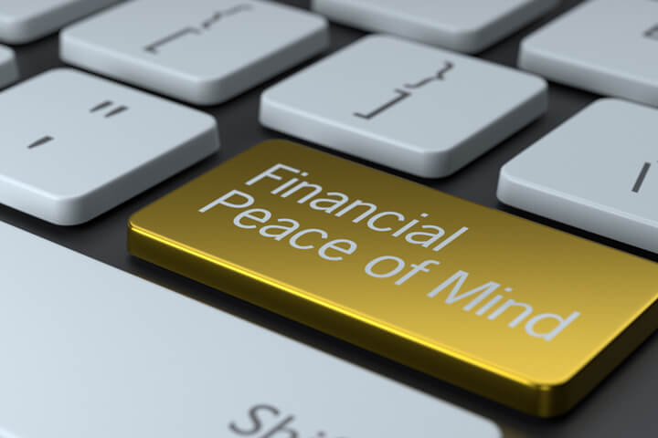Keyboard with metallic gold Financial Peace of Mind key