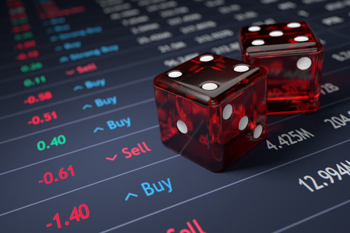 Stock ticker with two dice representing the risk involved with choosing investments