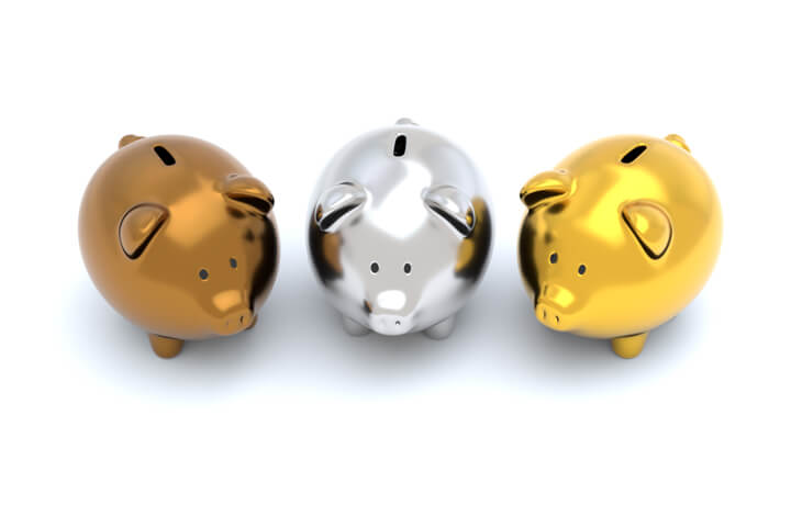 Three piggy banks one bronze, one silver, one gold isolated on white background