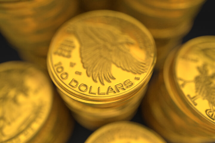Close-up image of stacks of 100 dollar U.S. gold coins