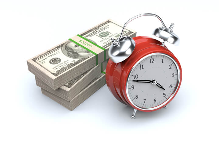 Red clock with stacks of $100 U.S. bills concept image