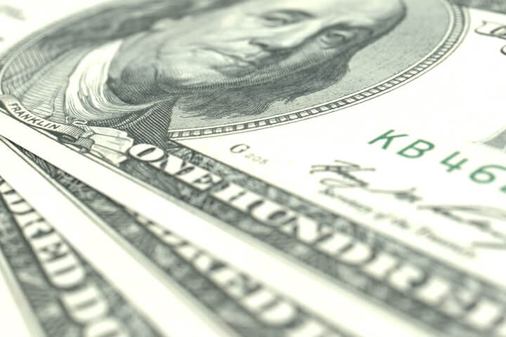 Image showing three 100 dollar U.S. bills close up at angle with short depth of field
