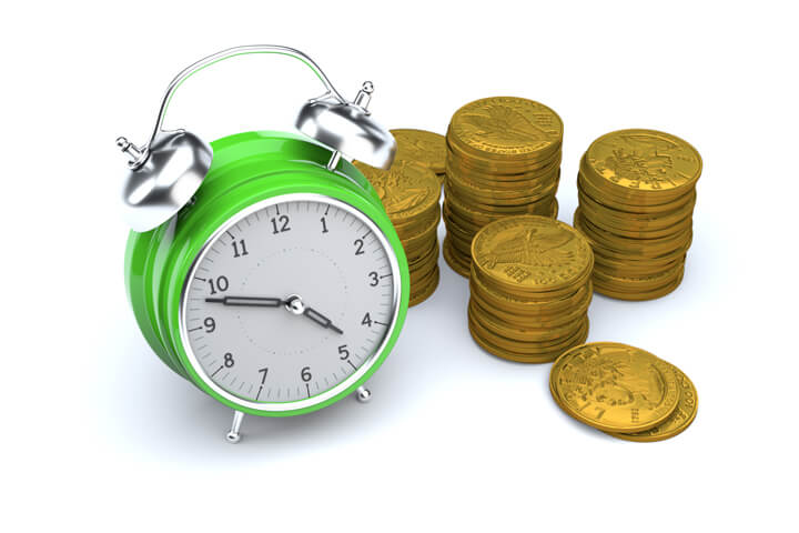 Concept image of green clock with stacks of gold U.S. coins