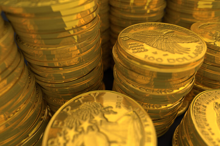 Close-up image of U.S. gold coins representing wealth, savings, or extreme wealth
