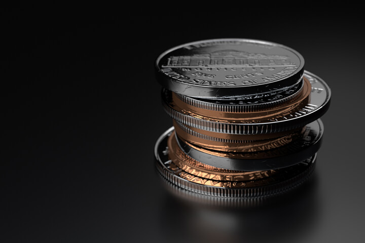 Small stack of assorted U.S. coins on dark shiny background