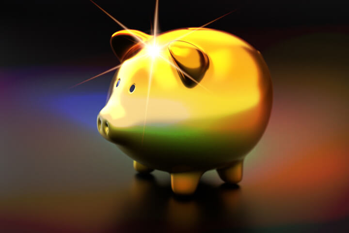 Metallic gold piggy bank with light burst and overlay effect