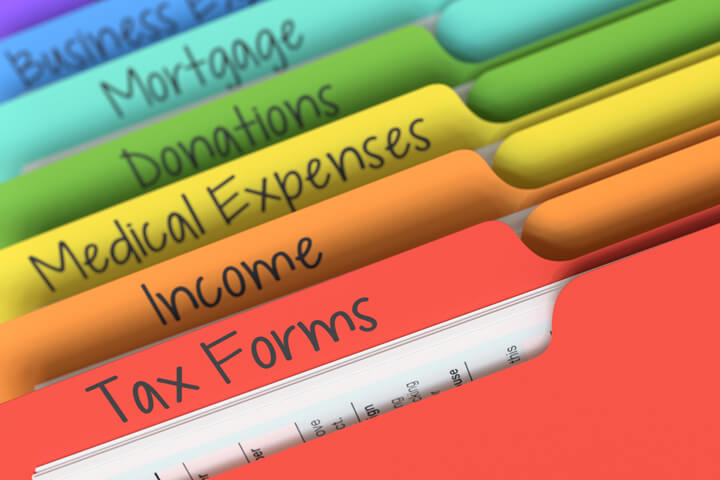 Colorful tax category folder tabs for forms, income, expenses, deductions, and mortgage expenses