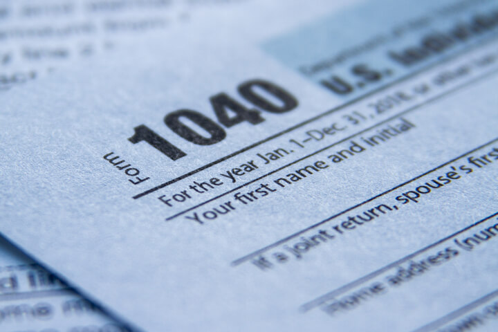 Close up photo of IRS form 1040 showing paper texture and depth of field blur