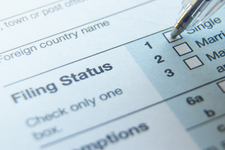Photo of 1040 tax form filing status with ballpoint pen on Single option