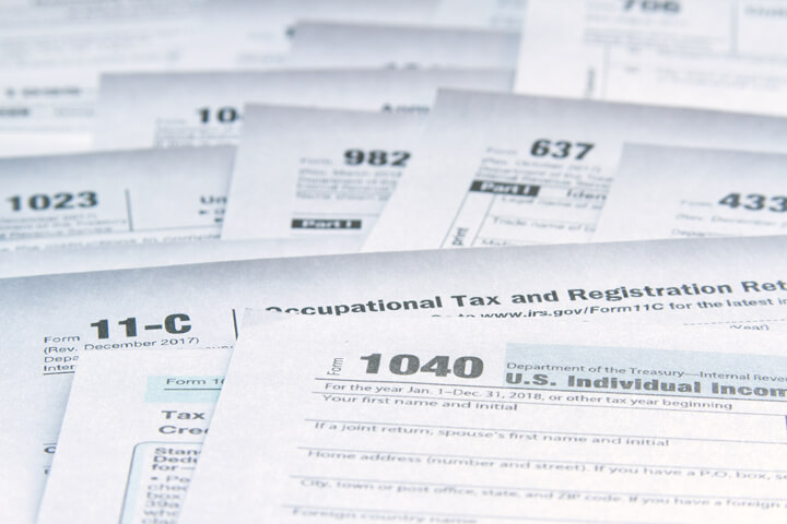 Photo of many tax forms concept demonstrating tax law complexity and need for simplification