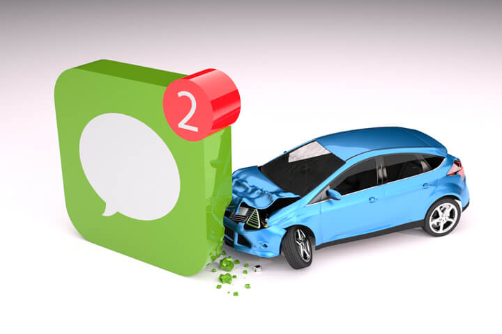 Blue compact car crashed into corner of cell phone message app icon texting while driving concept on white background