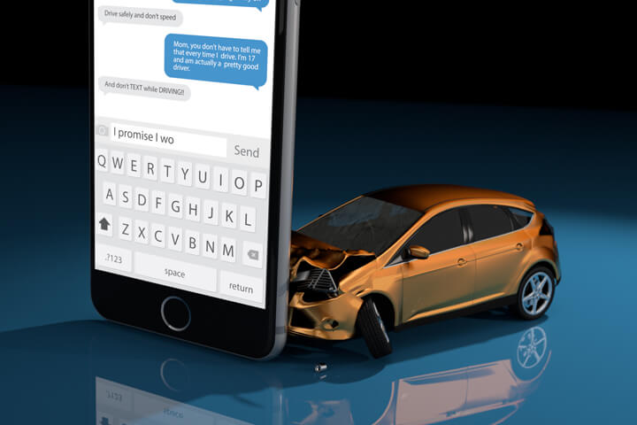 Orange compact car crashed into upright cell phone concept for texting while driving or distracted driving