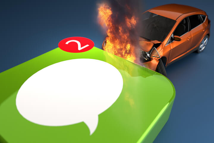 Texting while driving concept image showing vehicle on fire after crashing into side of imessage icon with message indicator