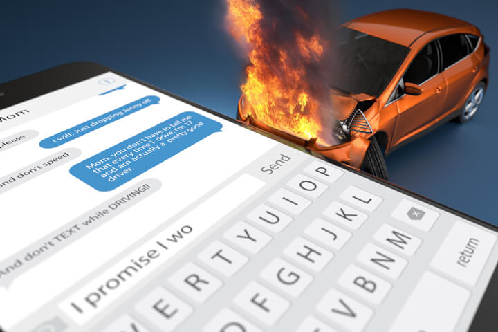 Concept image for texting while driving with car fire and large cell phone showing text message on screen