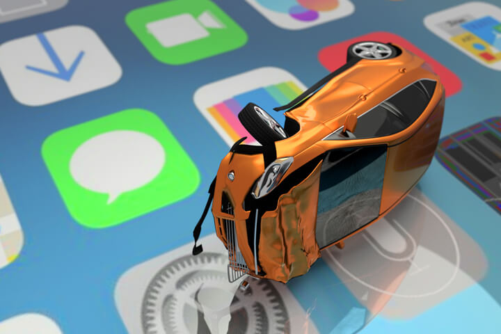 Car accident on top of cell phone screen showing various app icons