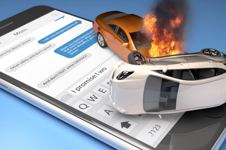 Two car accident with fire on top of iPhone with screen showing text messages